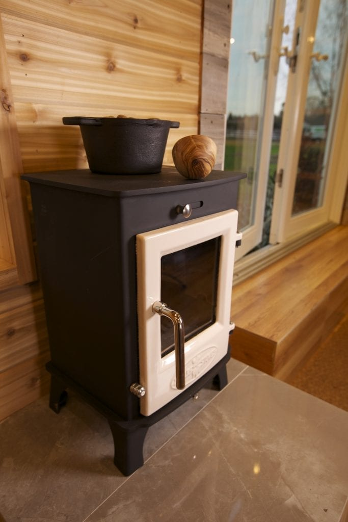 Dwarf 4kW Stove with beautiful wood background