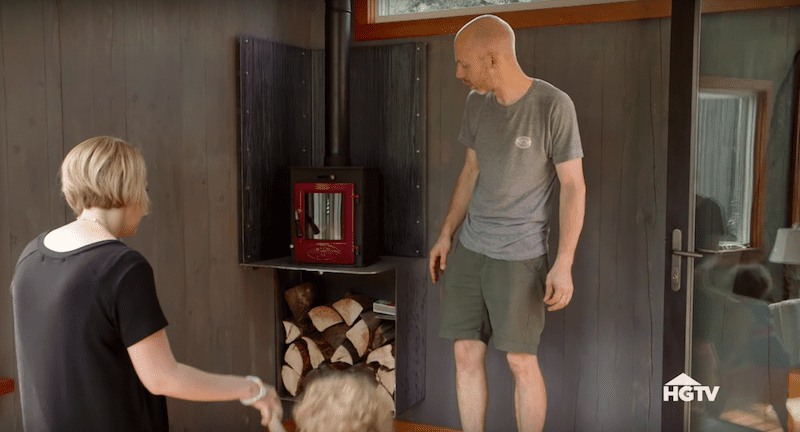 Mike showing his wife, Lisa, and son, Arthur their new tiny wood stove.