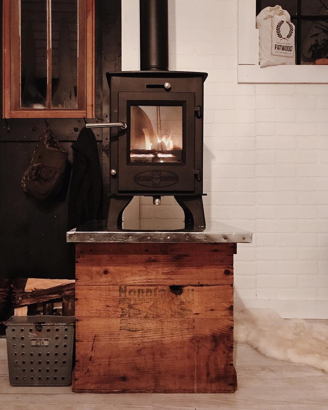 Tiny wood stove and custom stand.